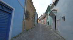 A narrow cobbled street in Sighisoara Stock Footage