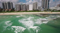Stock Video Footage of Aerial video of the waterfront, Miami Beach, 60th Collins Avenue. 4K Ultra HD.