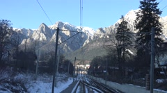 Stock Video Footage of 4K POV Point of view train pass mountain landscape window passenger winter day