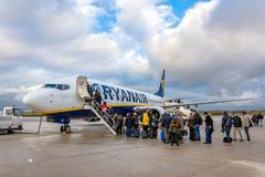 passengers boarding Ryanair Jet airplane - stock photo