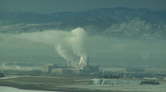 Industrial Steam Plume Rides Waves on Valley Inversion Stock Footage