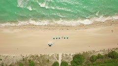 Top-down aerial footage of the sunny beach in Miami, Florida. 4K Ultra HD. Stock Footage