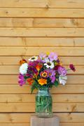 Flowers and wooden wall - stock photo