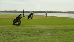 Algarve QDL Ria Formosa Park Golfer in Green waterscape scenery (Shot 4) Stock Footage