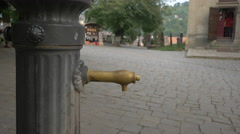 A drinking fountain in Museum Square, Sighisoara Stock Footage
