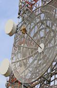 Large telecommunications antennas and repeaters of television Stock Photos