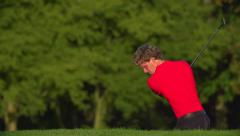 Great chip out of bunker, exploding sand and celebration! Stock Footage