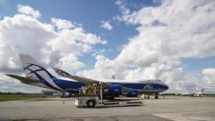 Unloading AirBridgeCargo plane parked Stock Footage