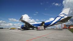 Unloading AirBridgeCargo plane parked - stock footage