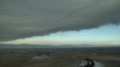 Time Lapse of Sharp Cloud Bank Streaming off Rockies Stock Footage