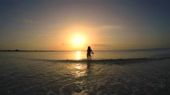 Sunrise beautiful Asian Chinese girl in bikini on the beach Stock Footage
