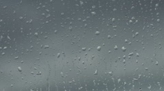 Close Up of Rain Drops Splattering on Window in Storm Stock Footage