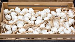 Garlic bulbs in the marketplace Stock Photos