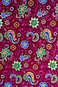Thailand sarong of vintage print fabric striped flowers and paisley for backg Stock Photos