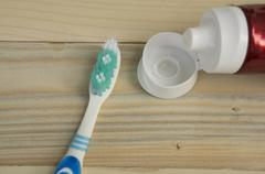 Toothbrush brush held hold dental dentist handhold concept Stock Photos