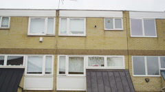 4K Exterior view of residential terraced housing in a London Suburb. - stock footage