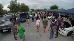 People flocking in public car show Stock Footage