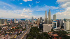 Beautiful timelapse of rolling clouds and sun rays over Kuala Lumpur Stock Footage