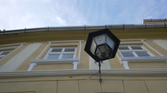 Old lamp on a building in Sighisoara Stock Footage