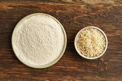 Whole-grain rice and rice flour - stock photo