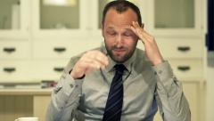 Tired businessman having headache during work with documents at home at night - stock footage