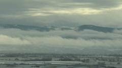 Time Lapse of Spooky Low Clouds over Valley after Winter Storm Stock Footage