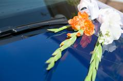 Gladiolus Flowers on Wedding Car Closeup Stock Photos