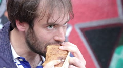 Young man eating kebab - street food Stock Footage