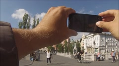 Man taking photo on smartphone - stock footage
