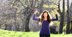 Beautiful young woman cheering and waving excitedly Stock Footage
