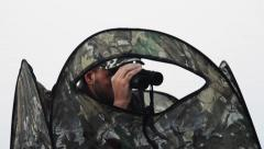 Hunter and binoculars, hunter hunting concept Stock Footage