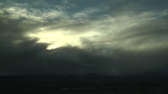 Strong Winds Blow Snow Clouds Off Mountains Stock Footage