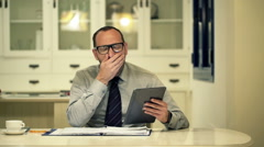 Tired, overworked businessman yawning during work at home and taking nap Stock Footage