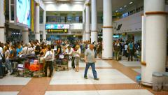 Airline travelers lined up at the departure counters in Phuket Airport Stock Footage