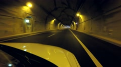 Car driving on highway tunnel Stock Footage