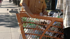 Cart with empty soda cans and bottles for recycling in Harlem NYC Stock Footage