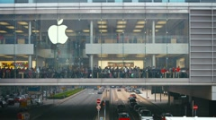 Apple Store, in a section of building suspended over a thoroughfare. Hong Kon - stock footage