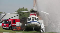 Firefighters in special suits extinguish the fire by helicopter Stock Footage