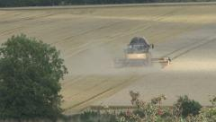 Stock Video Footage of Combine harvester at work on wheat.