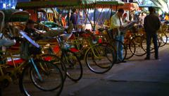 Many tricycle rickshaws, waiting in line for passengers in a busy shopping area Stock Footage