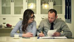 Businesspeople signing documents, legal deal sitting by table at home at night Stock Footage