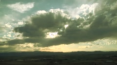 Time Lapse of Ragged Clouds Rocky Mountain Sunset Stock Footage