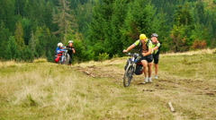 Mountain bikes climbs the hill Stock Footage