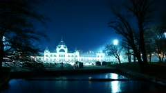 People iceskate in the famous Budapest City Park icerink at night Stock Footage