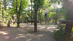 Children playing in the park to train climbers. Solar flare on the camera Stock Footage