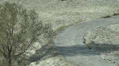 Time Lapse of Sun Melting Snow on Country Road - stock footage