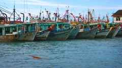 Traditional, wooden fishing boats, moored together at a pier in Borneo Stock Footage