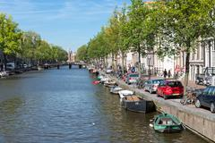 Canal in Amsterdam with historic mansions Stock Photos