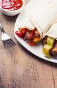 Fajitas , mexican beef stripes with grilled vegetable in tortilla wraps - stock photo