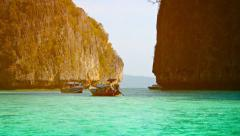 Boats Cruise Slowly around the Limestone Formations in Thailand Stock Footage